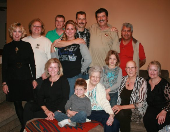 Mike with son Sean top center of photo, surrounded by extended family