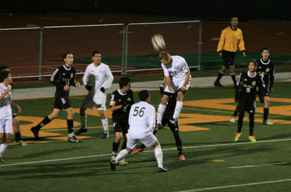 Blake goes up for the header