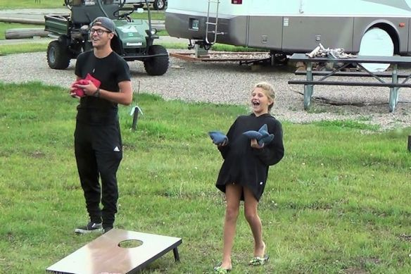 Blake and Paige Playing Corn Hole
