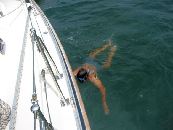 Mike Dives To Clean The Bottom Of The Hull