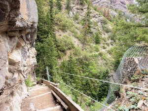 The trail included a series of steep stairs down the cliff after exiting a tunnel.