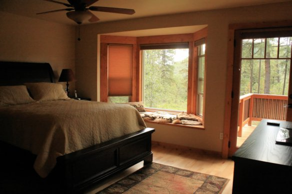 The master bedroom bay window and door to the private deck with spa.