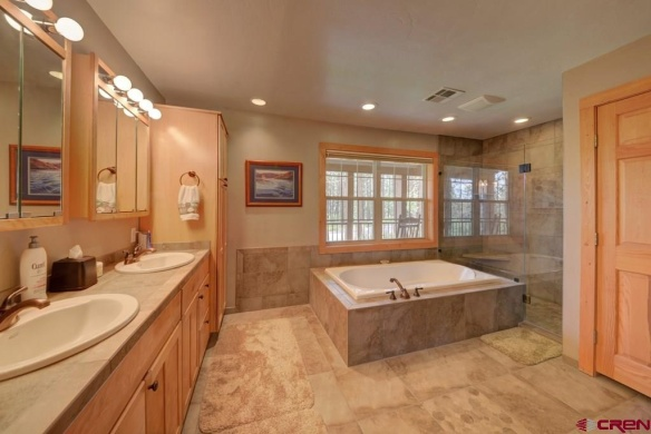 The master bath is nice and big with his and her sinks, a soaking tub, and a big shower with double shower heads.
